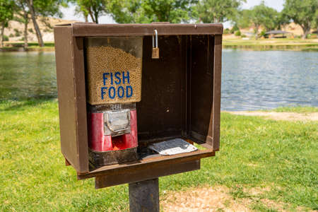 Fish food dispenser for feeding fish - taken in Thermopolis, Wyoming at Hot Springs State Park