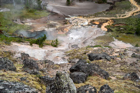 Colorful hot springs and geysers at the Artists Paint Pots hiking area in Yellowstone National Park