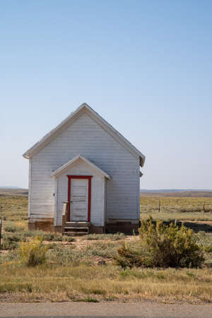 Old, abandoned whitewashed small building, taken in rural Wyoming, near Carter