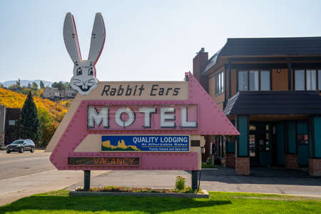 Steamboat Springs, Colorado - September 20, 2020: Vintage retro neon sign for the Rabbit Ears Motel, named after the nearby Rabbit Ears pass