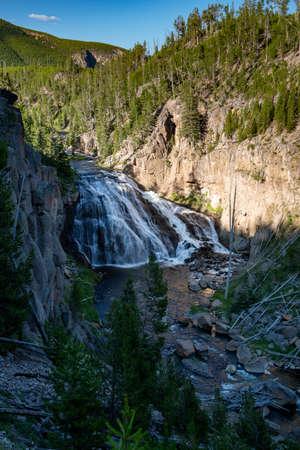 Gibbon Falls Waterfall in Yellowstone National Park. Daytime Long exposure