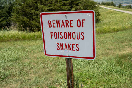 Sign - Beware of Poisonous Snakes, warning hikers of danger