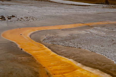 Orange hot spring geyser in Yellowstone National Park