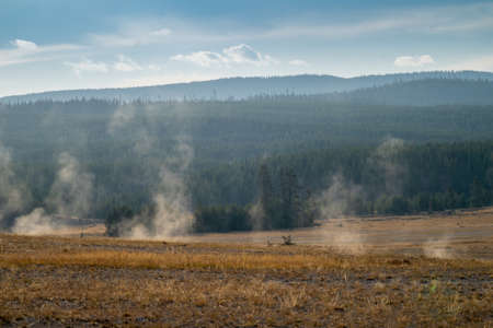Steam rises from hot springs in Yellowstone National Park in the early morning hours in autumn 版權商用圖片