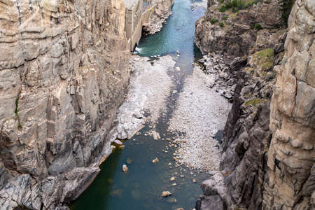 Looking down on the Shoshone River at the Buffalo Bill dam and reservoir in Cody Wyoming, with rocks in the water
