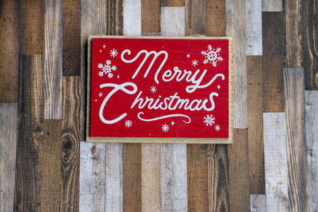 Red Merry Christmas concept on wood plank background, for holiday projects