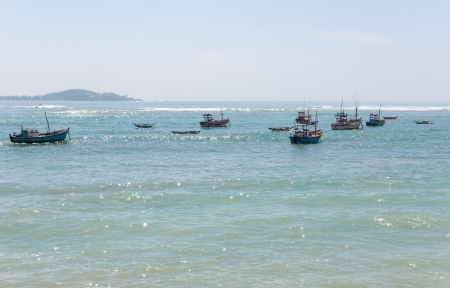 Fishboats on Indian Ocean, southern coast of Sri Lanka  photo