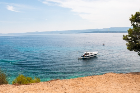 brac: Motorboat on a sea near town of Bol, Brac Island Stock Photo