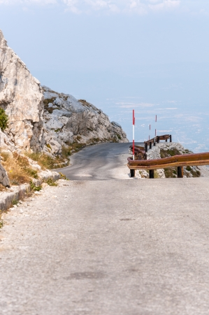 jure: Winding, narrow road from sv Jure peak in Biokovo mountains, Croatia
