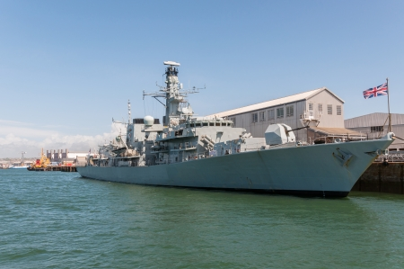 hms: British battleship in harbor, Plymouth, Great Britain