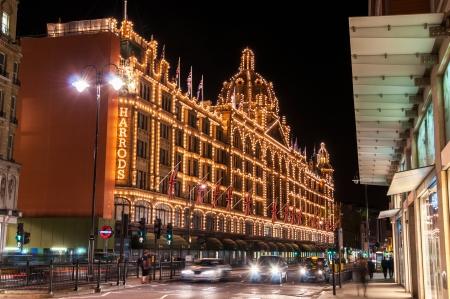 departmentstore: Illuminated Harrods shopping center at night in London, Great Britain