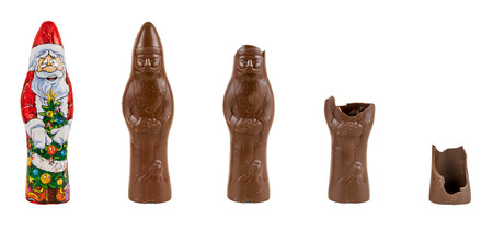 Chocolate figure of santa Claus is being eaten  5 steps isolated over white background with clipping path  Imagens