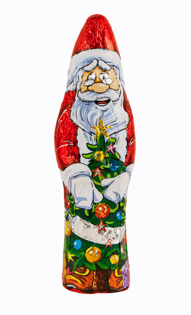 Wrapped chocolate figure of santa Claus isolated over white background with clipping path  Imagens