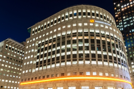 London, United Kingdom - May 9, 2011  Illuminated Thomson Reuters Building situated at Canary Wharf in London at night  Thomson Reuters Corporation is a multinational media firm that provides information for businesses and professionals