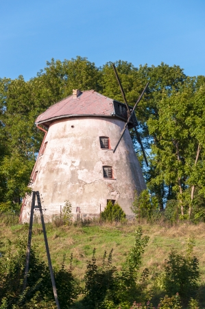 Old, broken mill in Masurian Lakes District of northern Poland photo