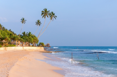 Tropical beach in southern part of Sri Lanka at sunset photo