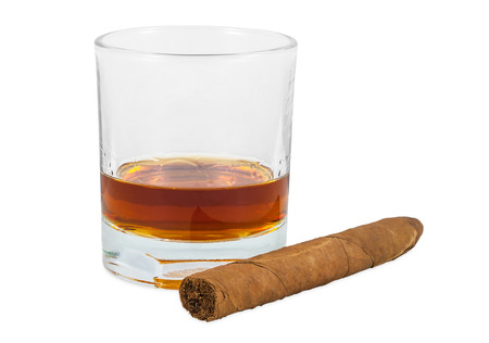 Glass of whiskey and cigar isolated on white background  photo