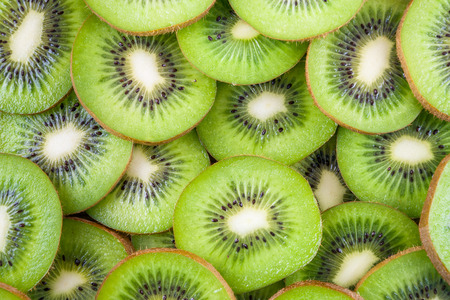 Background of fresh ripe kiwi fruit slices photo