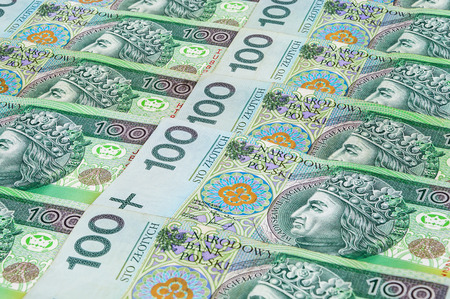 Background of 100 PLN (polish zloty) banknotes laying in a row Imagens