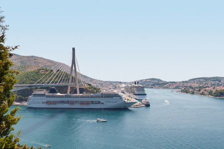 Cruise ships anchored in croatian port of Dubrovnik photo