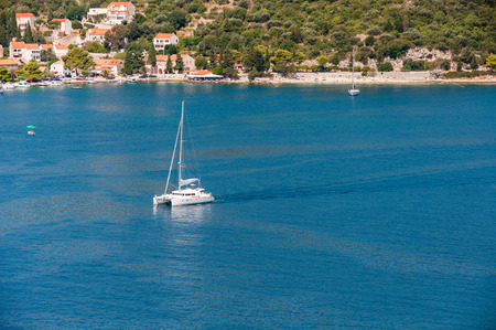 Sailing yacht in bay near Zaton in Croatia photo