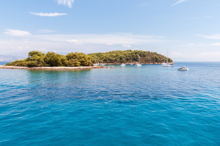 Yachts in a bay at Zacevo Island in Croatia photo