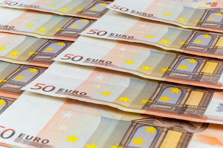 Background of 50 euro banknotes laying in a row photo