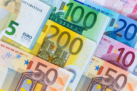 Closeup of euro banknotes forming a money background photo