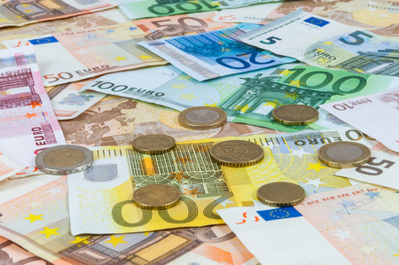 Background made of euro banknotes and coins photo