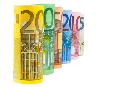 Set of rolled euro banknotes isolated on white background with clipping path photo