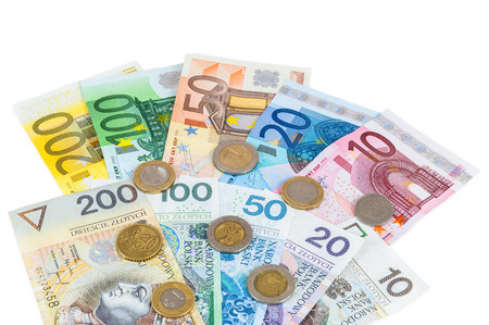 valorization: Euro and new polish zloty banknotes with coins isolated