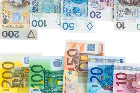 valorization: Euro and new polish zloty banknotes isolated