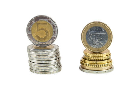 Stack of polish zloty and euro coins isolated  Stock Photo