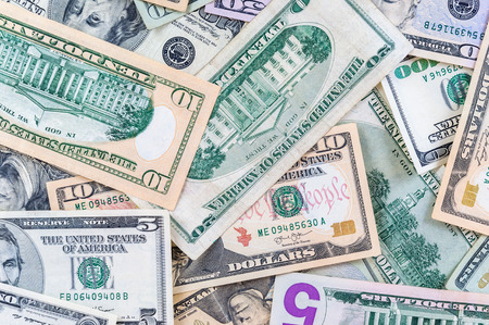 Closeup of dollar banknotes forming a money background photo