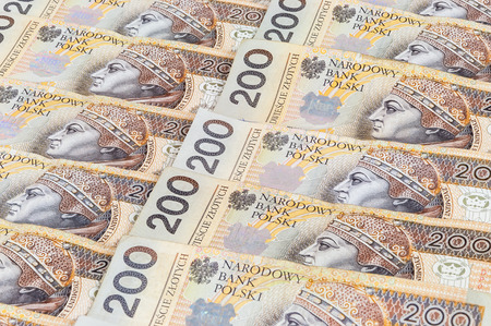 Background of 200 PLN - polish zloty banknotes laying in a row