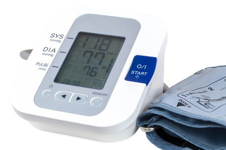 Digital blood pressure monitor isolated on white background with clipping path photo