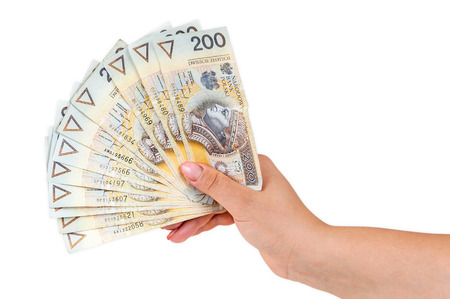 Hand holding 200 polish zloty banknotes isolated on white background with clipping path