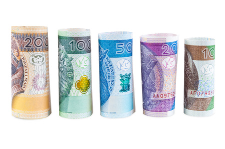 Rolled polish zloty new banknotes isolated on white background with clipping path