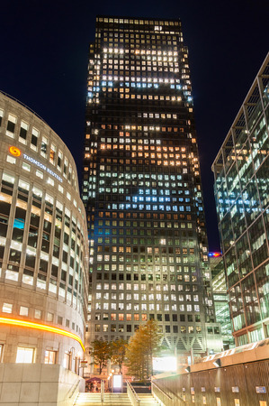LONDON, UNITED KINGDOM - May 9  Canary Wharf skyscraper and the Thomson Reuters building at night on May 9, 2011 in London  Canary Wharf is one of London