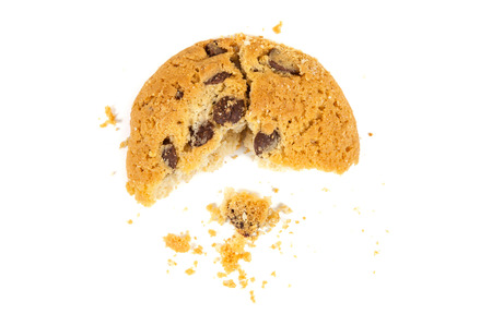 Half eaten chocolate chips cookie isolated on white background Imagens