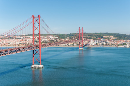 25th of April Suspension Bridge over the Tagus river in Lisbon, Portugal photo