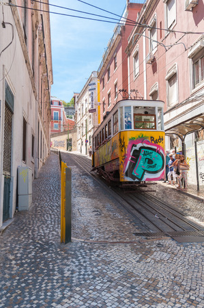 gloria: LISBON, PORTUGAL - AUGUST 23: The Gloria Funicular is a funicular that links Baixa with Bairro Alto districts in Lisbon on August 23, 2014. The Gloria Funicular was opened to the public on October 24, 1885