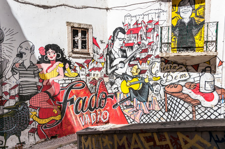 LISBON, PORTUGAL - AUGUST 23: Graffiti of traditional portuguese fado on the street of Lisbon on August 23, 2014. Fado is a music genre which can be traced to the 1820s in Portugal.