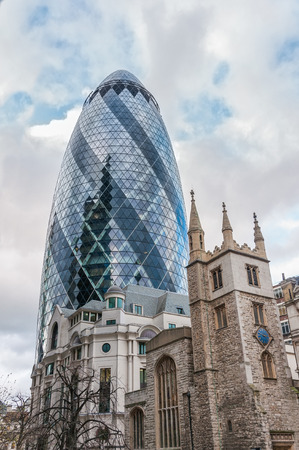 30 st mary axe: LONDON, UNITED KINGDOM - NOVEMBER 7, 2014: View of Gherkin skyscraper (30 St Mary Axe). It is a commercial building in London Editorial