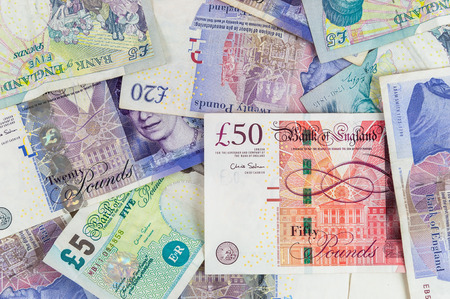 gbp: Background made of english pounds banknotes - pile of money Stock Photo