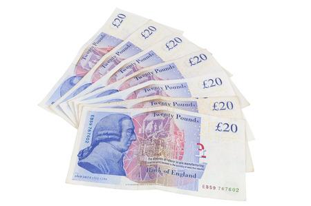libra esterlina: La cifra de billetes de 20 libras inglés aislados sobre fondo blanco con trazado de recorte Foto de archivo