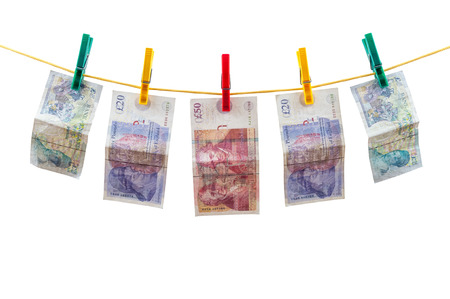 English pounds banknotes on clothesline isolated on white background with clipping path