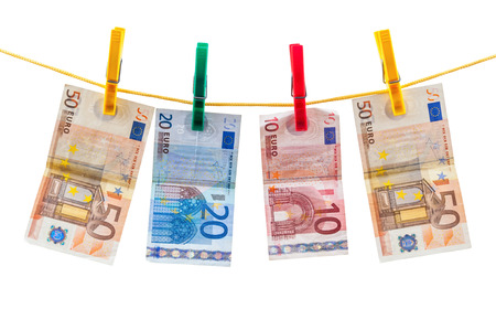 Euro banknotes on clothesline isolated on white background with clipping path