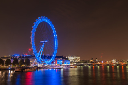 millennium wheel: LONDON, UNITED KINGDOM - NOVEMBER 10, 2014: Night view of the South Bank of the River Thames including the world famous landmark, London Eye.