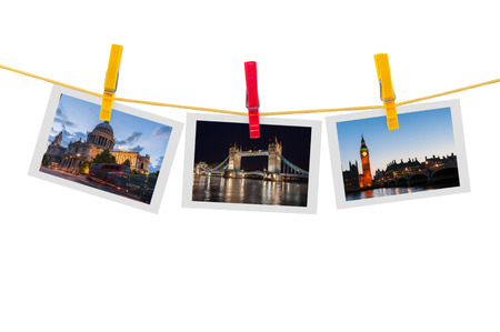 Three photos of London on clothesline isolated on white background photo